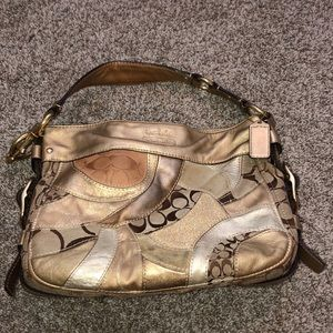 Gold and brown authentic coach purse